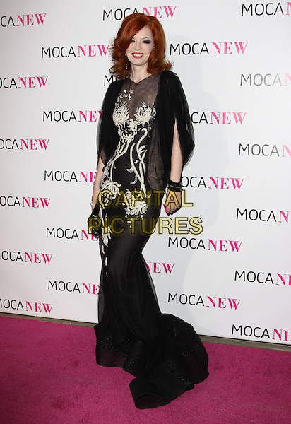 SHIRLEY MANSON .At MOCA's 30th Anniversary Gala held at MOCA, Los Angeles, California, USA, 14th November 2009. .full length dress black sheer see through bracelet sleeve long maxi white embroidered layered pattern grey gray clutch bag silk chiffon .CAP/ADM/KB.©Kevan Brooks/AdMedia/Capital Pictures.