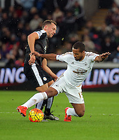 Wayne Routledge of Swansea (R) tackles Danny Drinkwater of Leicester City  during the Barclays Premier League match between Swansea City and Leicester City at the Liberty Stadium, Swansea on December 05 2015