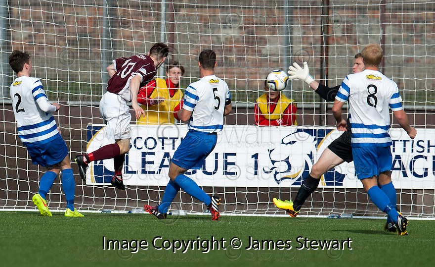 Stenny's Sean Dickson scores their second goal.