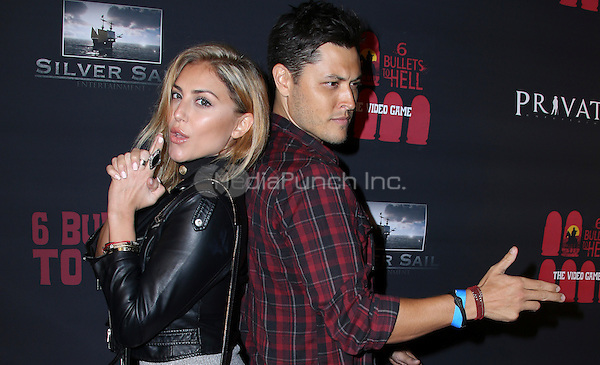 LOS ANGELES, CA - MAY 10: Blair Redford, Cassie Scerbo arrives at the '6 Bullets To Hell' Mobile Game Launch Party on May 10, 2016 in Los Angeles, California. Credit: Parisa/MediaPunch.