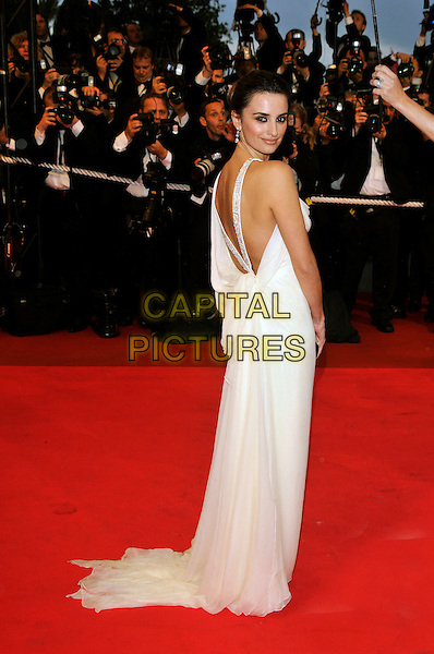 "PENELOPE CRUZ.""Vicky Cristina Barcelona"" premiere (Woody Allen film).61st Cannes International  Film Festival, France.17th May 2008 .full length white cream dress bare back looking over her shoulder red carpet photographers.CAP/PL.© Phil Loftus/Capital Pictures"