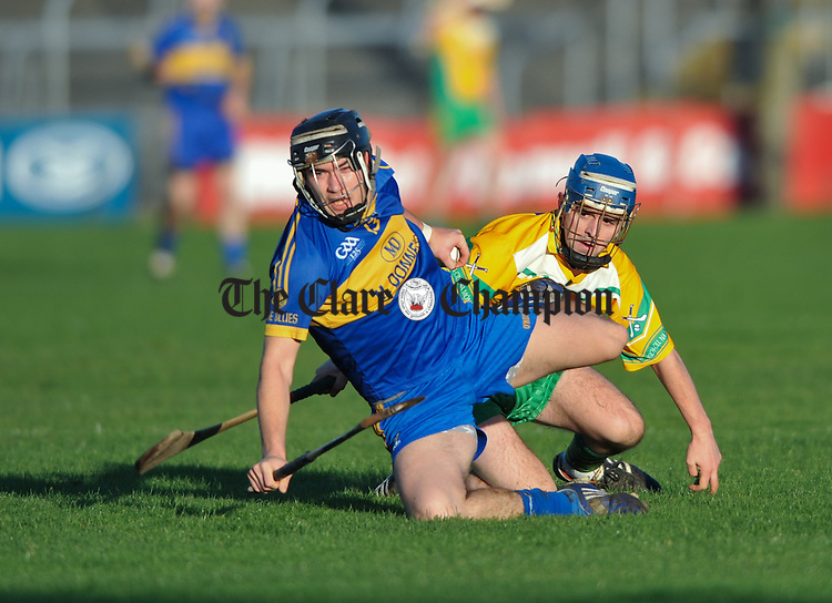 Milo Keane of Inagh-Kilnamona in action against Eoin Hayes of Newmarket during the Clare Champion Cup final at Cusack Park. Photograph by John Kelly.