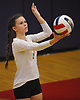 Emma Profitlich #1 of Sacred Heart Academy serves during the second set of a CHSAA varsity girls volleyball match against host St. John the Baptist High School in West Islip on Thursday, Oct. 12, 2017. Sacred Heart won the match 3-0.