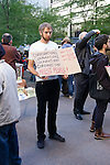 "Protester holds ""Corporations Aren't People sign"" at the Occupy Wall Street Protest in New York City October 6, 2011."