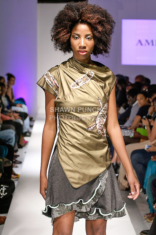 Model walks runway in an outfit from the Amparo Spring Summer 2013 collection by Iliana Quander, during BK Fashion Weekend Spring Summer 2013, September 27, 2013.