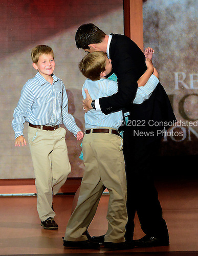 United States Representative Paul Ryan (Republican of Wisconsin), the GOP nominee for Vice President of the United States hugs his children following his speech at the 2012 Republican National Convention in Tampa Bay, Florida on Wednesday, August 29, 2012.  .Credit: Ron Sachs / CNP.(RESTRICTION: NO New York or New Jersey Newspapers or newspapers within a 75 mile radius of New York City)