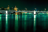 Lyon, France, Rhone river bridge and town, lighted at night.