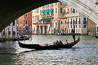 Tourist take snap shots from a gondola as they pass under the Rialto Bridge. Completed in 1591, the Rialto Bridge was the only bridge crossing the canal until the Accademia Bridge was built in 1854.