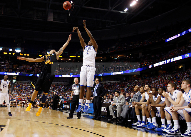Darius Miller makes a three in the second half of UK's second round NCAA tournament win, 71-63, against West Virginia at the St. Pete Times Forum in Tampa, Florida on Saturday, March 19, 2011.  Photo by Britney McIntosh | Staff