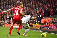 Sunday, 23 February 2014<br /> Pictured: Swansea City's Pablo Hernandez battles with Liverpool's Jon Flanagan<br /> Re: Barclay's Premier League, Liverpool FC v Swansea City FC v at Anfield Stadium, Liverpool Merseyside, UK.