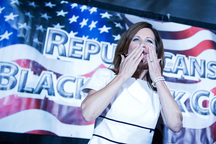 UNITED STATES - AUGUST 14:  Republican presidential candidate Rep. Michele Bachmann, R-Minn., blows a kiss to crowd assembled for the Lincoln Day Dinner hosted by the Black Hawk County Republican Party in Waterloo, Iowa.  Candidates Bachmann, Rick Santorum, and Texas Gov. Rick Perry, addressed the gathering.  (Photo By Tom Williams/Roll Call)