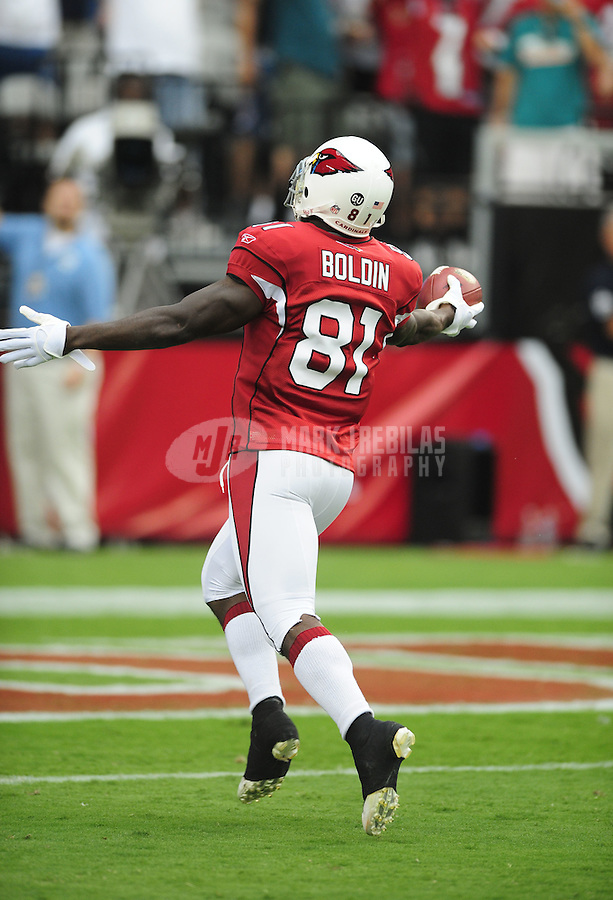 Sept. 14, 2008; Glendale, AZ, USA; Arizona Cardinals wide receiver (81) Anquan Boldin runs for a first quarter touchdown against the Miami Dolphins at University of Phoenix Stadium. Mandatory Credit: Mark J. Rebilas-