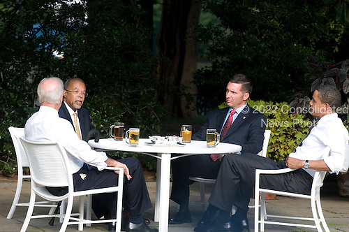Washington, D.C. - July 30 2009 -- United States President Barack Obama, right, and Vice President Joseph Biden, left, meet with Sergeant James Crowley, right center, and Professor Henry Louis Gates Jr., left center, in the Rose Garden outside the Oval Office at the White House in Washington, D.C. on Thursday, July 30, 2009..Credit: Ron Sachs / CNP.(RESTRICTION: NO New York or New Jersey Newspapers or newspapers within a 75 mile radius of New York City)
