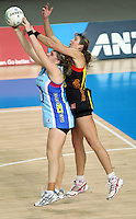 28.06.2010 Magic's Irene Van Dyk and Steels Te Huinga Reo Selby-Ricket in action during the ANZ Champs Semi Final netball match between the Magic and Steel played at Vector Arena in Auckland. ©MBPHOTO/Michael Bradley