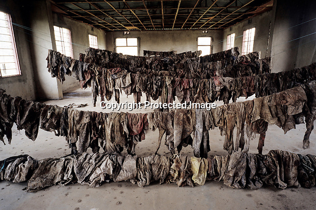 Clothes and belongings from victims of Genocide on display at Murambi memorial site on February 23, 2003 in Murambi outside Gikongoro, Rwanda. About 800.000 mainly Tutsis and moderate Hutus were killed in about one hundred days in 1994, and about 100.000 prisoners accused of the genocide are still in prison awaiting trial. Rwanda is currently trying to cope with these huge problems and some prisoners that confessed to crimes can be tried in village Photo: (Per-Anders Pettersson)