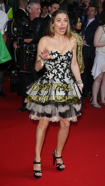 ELEN RIVAS .Royal Premiere of 'Arabia 3D' at the BFI Imax cinema, London, England, UK,.May 24th 2010.full length black strapless tulle layered layered tiered dress hand mouth open funny grey gray patterned pattern platform strappy sandals  .CAP/ROS.©Steve Ross/Capital Pictures.