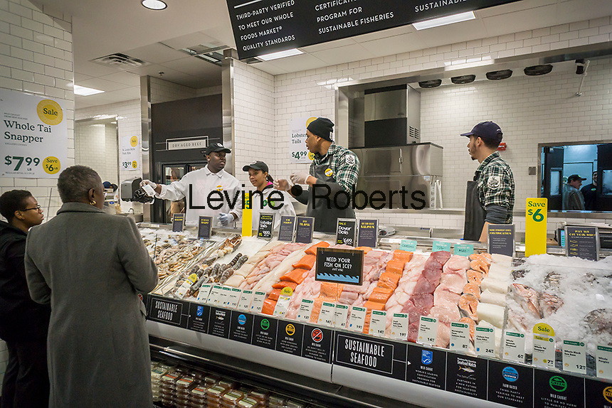 Seafood department in the new Whole Foods Market in Newark, NJ on opening day Wednesday, March 1, 2017. The store is the chain's 17th store to open in New Jersey. The 29,000 square foot store located in the redeveloped former Hahne & Co. department store building is seen as a harbinger of the revitalization of Newark which never fully recovered from the riots in the 1960's.  (© Richard B. Levine)