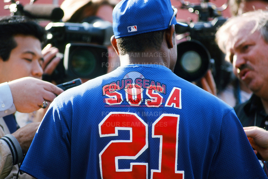 Sammy Sosa of the Chicago Cubs is interviewed before a 1999 Major League Baseball season game against the Los Angeles Dodgers in Los Angeles, California. (Larry Goren/Four Seam Images)