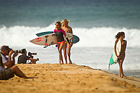 North Shore/Oahu/Hawaii (Friday, November 25, 2011) Girls going surfing. – Free surfing session at Rocky Point in 3'-4' side shore trades. . Photo: joliphotos.com