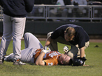 April 20, 2004:  Third baseman Matt Moses (36) of the Swing of the Quad Cities, Class-A Midwest League affiliate of the Minnesota Twins, gets checked by the trainer after fouling a ball off his ankle during a game at Fifth Third Field in Dayton, OH.  Photo by:  Mike Janes/Four Seam Images