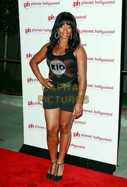 MONIQUE COLEMAN.Planet Hollywood Resort & Casino Grand Opening - Day 2 held at the Planet Hollywood Resort & Casino, Las Vegas, Nevada, USA..November 17th, 2007 .full length shorts tank top rio silver hand on hip t-bar shoes shorts .CAP/ADM/MJT.©MJT/AdMedia/Capital Pictures.
