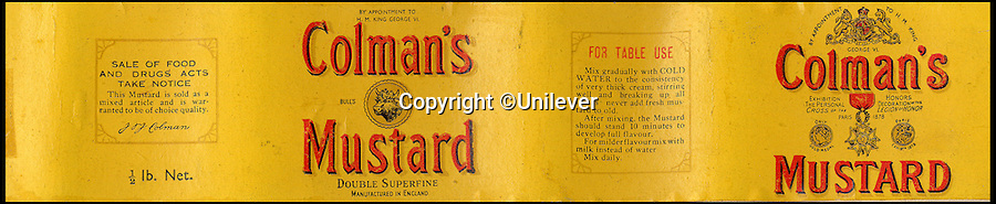 BNPS.co.uk (01202 558833)<br /> Pic: Unilever/BNPS<br /> <br /> Austerity mustard from 1940 -  a WW2 paper shortage made the labels smaller.<br /> <br /> A staple of the British kitchen is celebrating its anniversary this year as Colman's Mustard turns 200.<br /> <br /> Archivist's research reveals the 200 year history of Colmans mustard.<br /> <br /> Founded in Norwich in 1814 by Jeremiah Colman, the super hot condiment made from Norfolk mustard seeds soon become a family favourite at dinner tables throughout the Empire, with even Capt Scott taking a case on his ill fated Terra Nova expedition to the south pole.<br /> <br /> So vital was the powdered sauce that it escaped wartime rationing to keep the home fires burning during the dark days of WW2. <br /> <br /> Despite being founded a year before Napoleon met his Waterloo, the world famous brand still produces 3000 tons of the fiery favourite every year exporting to all parts of the globe.