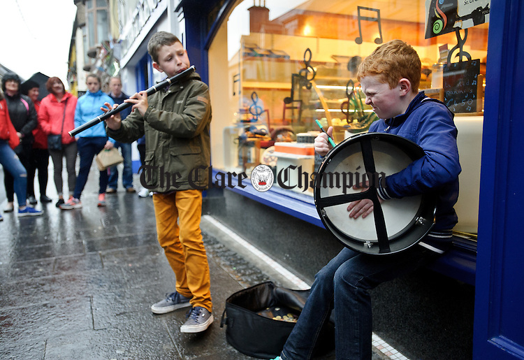 Brothers Neil and Adam Martin of Kilcolgan playing in the street at Fleadh Cheoil na hEireann in Ennis. Photograph by John Kelly.