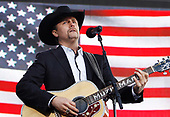 New York, NY - November 11, 2008 -- John Rich performs before United States President George W. Bush speaks on Veteran's Day at the rededication ceremony of the Intrepid Sea, Air and Space Museum in New York City on Tuesday, November 11, 2008. <br /> Credit: John Angelillo - Pool via CNP