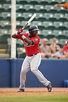 Birmingham Barons outfielder Courtney Hawkins (10) at bat during a game against the Biloxi Shuckers on May 24, 2015 at Joe Davis Stadium in Huntsville, Alabama.  Birmingham defeated Biloxi 6-4 as the Shuckers are playing all games on the road, or neutral sites like their former home in Huntsville, until the teams new stadium is completed.  (Mike Janes/Four Seam Images)