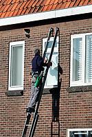 Nederland 2018. Glazenwasser aan het werk.  Foto Berlinda van Dam / Hollandse Hoogte