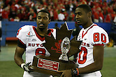 January 5th, 2008:  Rutgers players Marcus Daniels (9) and Keith Taylor (80) pose with the championship trophy after the International Bowl at the Rogers Centre in Toronto, Ontario Canada...Rutgers defeated Ball State 52-30.  ..Photo By:  Mike Janes Photography