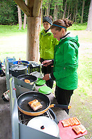 Guides Aileen and Katy Prepare Salmon Dinner, Jones Island, San Juan Islands, Washington, US