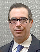 United States President-elect Donald Trump's nominee for Secretary of the Treasury Steven Mnuchin is seen waiting for an elevator lobby Trump Tower in New York, NY, USA on December 6, 2016. <br /> Credit: Albin Lohr-Jones / Pool via CNP