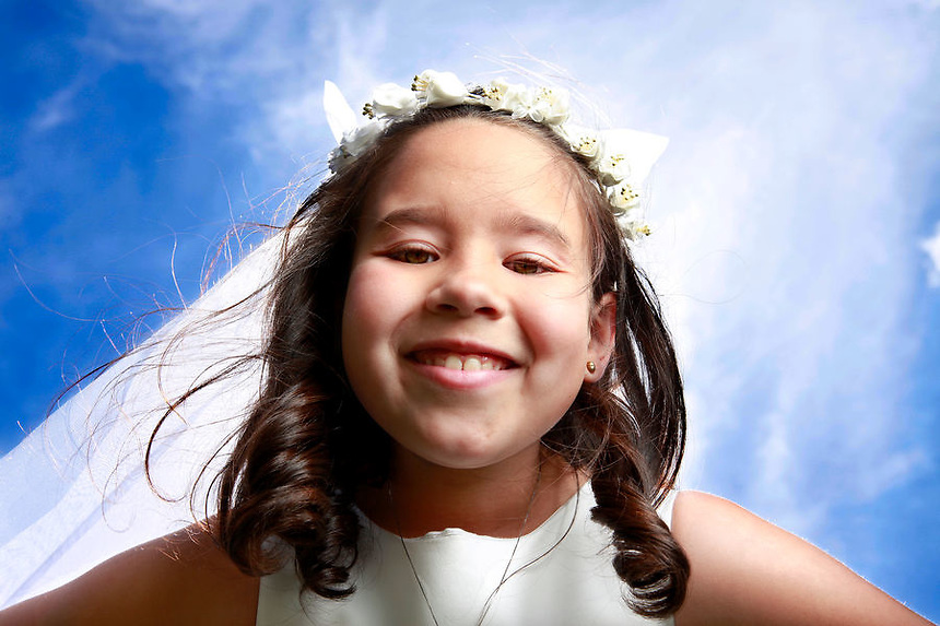 Amanda DeLaTorre on the day of her First Holy Communion, in the Pelham Bay section of the Bronx, NY on Saturday, May 15, 2010.