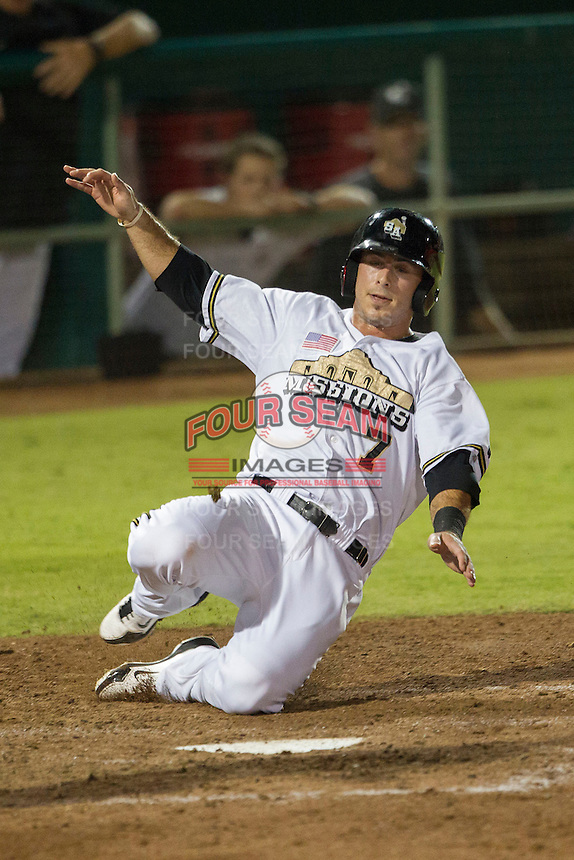 San Antonio Missions first baseman Tommy Medica (7) slides home during the Texas League baseball game against the Midland RockHounds on July 13, 2013 at Nelson Wolff Municipal Stadium in San Antonio, Texas. The Missions defeated the Rock Hounds 5-4. (Andrew Woolley/Four Seam Images)