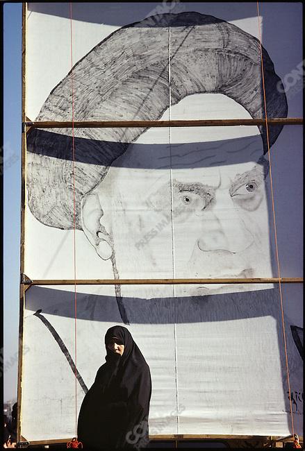 A woman at the Shahyad Monument awaits the return of the Ayatollah Khomeini. Tehran, January 26, 1979.