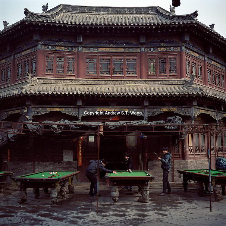 Chinese youths play pool outside an old Chinese building at the old city area of Yuci in Jinzhong City, Shanxi province, 2012. (Mamiya 6, 75mm f3.5, Kodak Ektar 160 film)