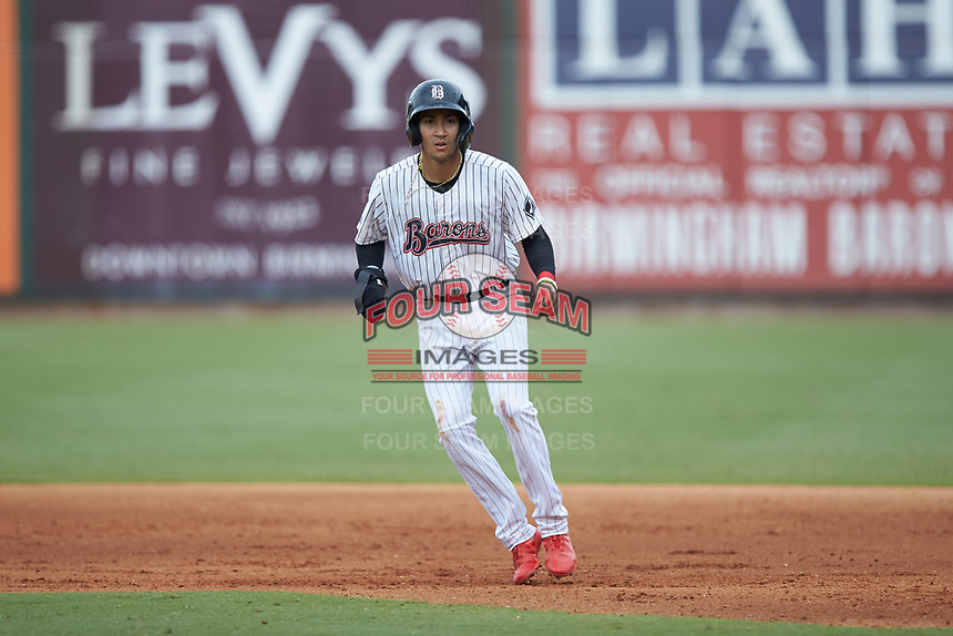Laz Rivera (5) of the Birmingham Barons takes his lead off of first base against the Pensacola Blue Wahoos at Regions Field on July 7, 2019 in Birmingham, Alabama. The Barons defeated the Blue Wahoos 6-5 in 10 innings. (Brian Westerholt/Four Seam Images)