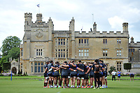 The Bath squad huddle together. Bath Rugby pre-season training session on August 18, 2014 at Farleigh House in Bath, England. Photo by: Patrick Khachfe/Onside Images
