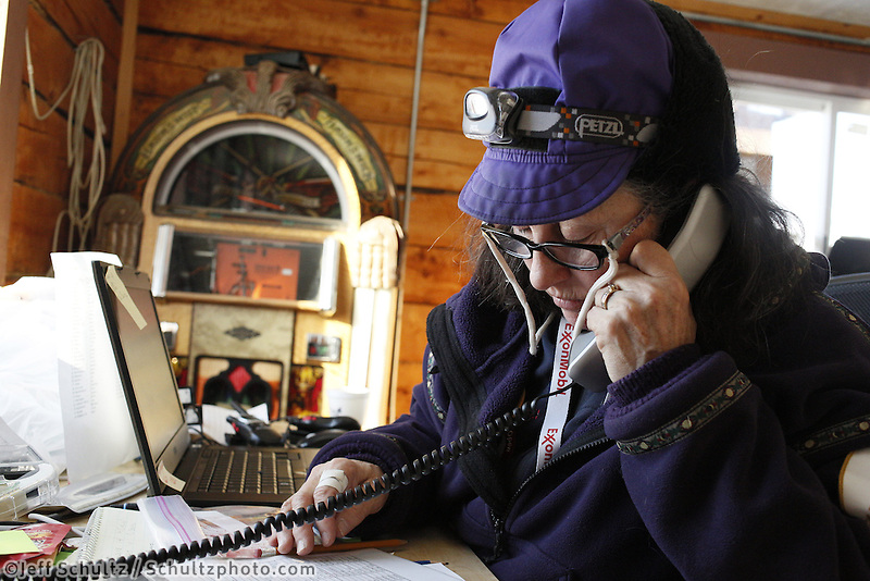 Volunteer Comms Nancy Yoshida works comms at the Shageluk checkpoint on Saturday March 9, 2013...Iditarod Sled Dog Race 2013..Photo by Jeff Schultz copyright 2013 DO NOT REPRODUCE WITHOUT PERMISSION