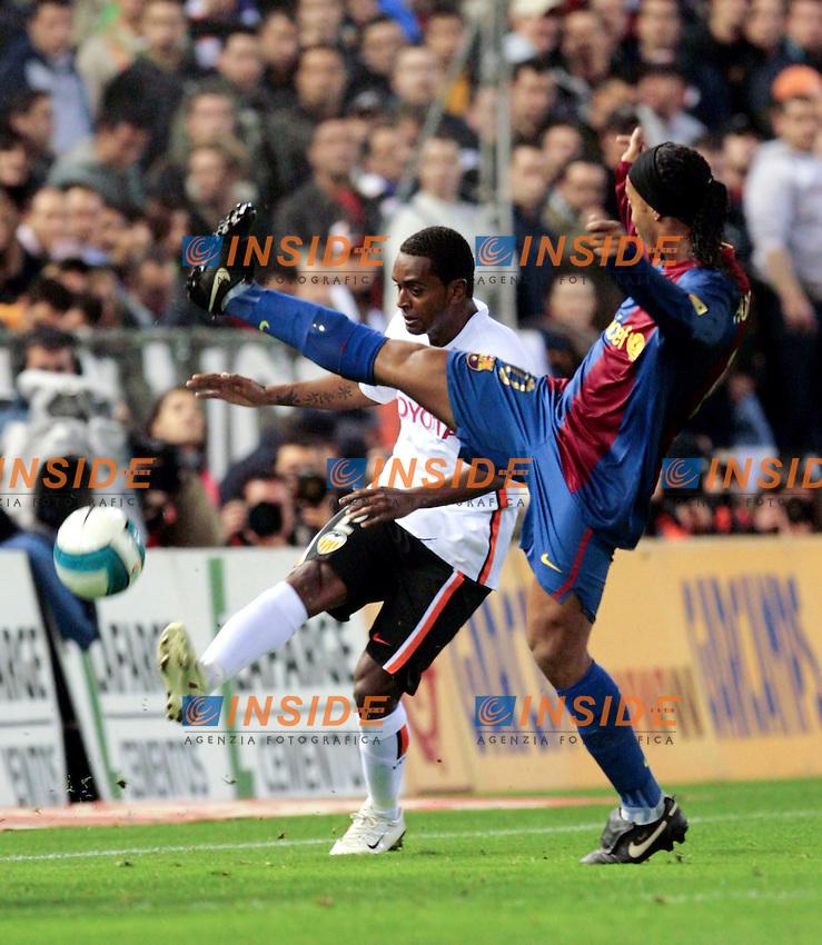 Barcelona`s Ronaldo de Assis Moreira Ronaldinho against Valencia`s Luis Miguel Brito during Spain`s La Liga match between Valencia and Barcelona at Mestalla Stadium in Valencia, Sunday 18 February, 2007, (INSIDE/ALTERPHOTOS/Jose Chavero).