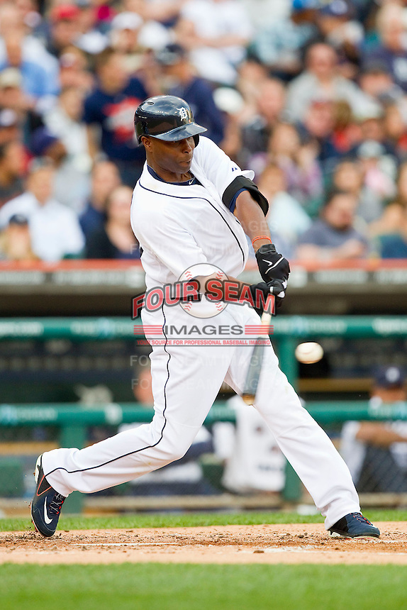 Torii Hunter (48) of the Detroit Tigers makes contact with the baseball against the Tampa Bay Rays at Comerica Park on June 4, 2013 in Detroit, Michigan.  The Tigers defeated the Rays 10-1.  Brian Westerholt/Four Seam Images