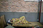 BUKAVU, DEMOCRATIC REPUBLIC OF CONGO - OCTOBER 30: An unidentified woman rests outside a ward as she is recovering from surgery on October 30, 2007 at Panzi hospital outside Bukavu, DRC. Many of these women has been raped and abused by rebels and government soldiers. About 10 women and girls show up at the hospital every day and Dr. Denis Mukwege, a gynecologist and his staff does up to 20 reconstructive operations every day. He often has to perform complicated surgery to reproductive and digestive parts of the women. The DRC conflict has seen an unprecedented high rate of rape and sexual abuse of women. The culprits are both different rebel groups and government soldiers and very few are punished. About 27,000 sexual assaults were reported in South Kivu province alone in 2006, according to the United Nations. (Photo by Per-Anders Pettersson)