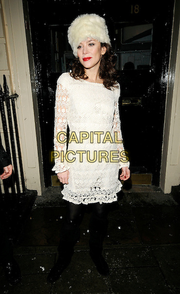 "ANNA FRIEL.Leaving after the evening performance of ""Breakfast At Tiffany's"", Theatre Royal Haymarket, London, England, .5th January 2010..full length white cream fur hat lace crochet dress long sleeved knee high boots .CAP/CAN.©Can Nguyen/Capital Pictures."