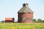 Weathered round masonry corncrib barn at a farm in western Illinois