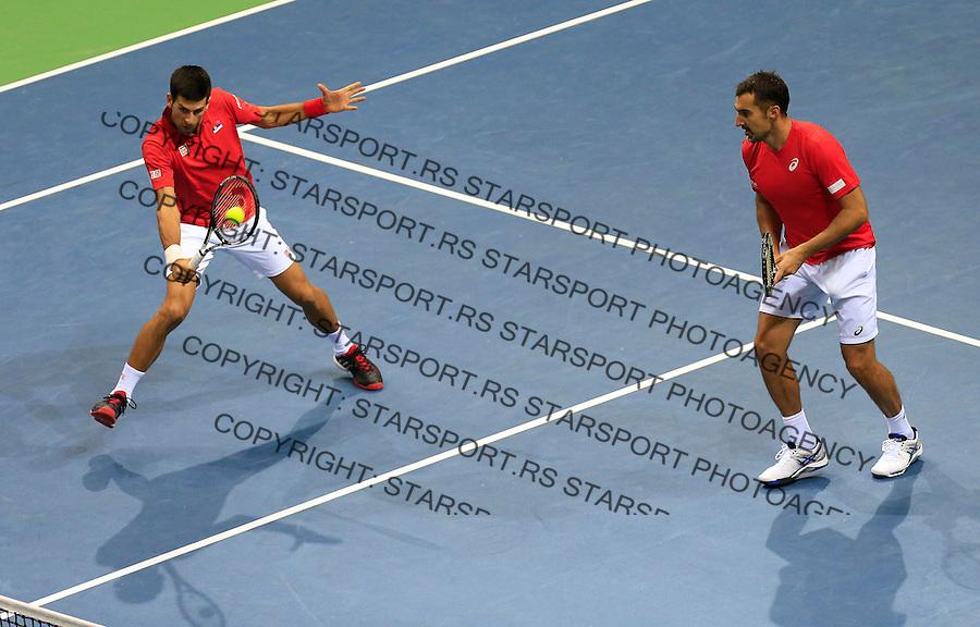 Davis Cup 2014 first round<br /> Srbija v Hrvatska<br /> Novak Djokovic and Nenad Zimonjic-Serbia v Franko Skugor and Marin Draganja doubles dublovi<br /> Nenad Zimonjic (R) and Novak Djokovic<br /> Kraljevo, 07.03.2015.<br /> Foto: Srdjan Stevanovic/Starsportphoto.com&copy;