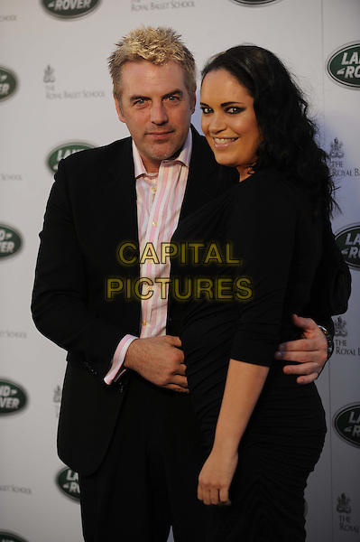 Donal MacIntyre & Ameera De La Rosa.The All New Range Rover launch at the Royal Ballet School in Richmond Park, London, England..6th September 2012.half length black suit side arm around waist dress married husband wife .CAP/CAS.©Bob Cass/Capital Pictures.