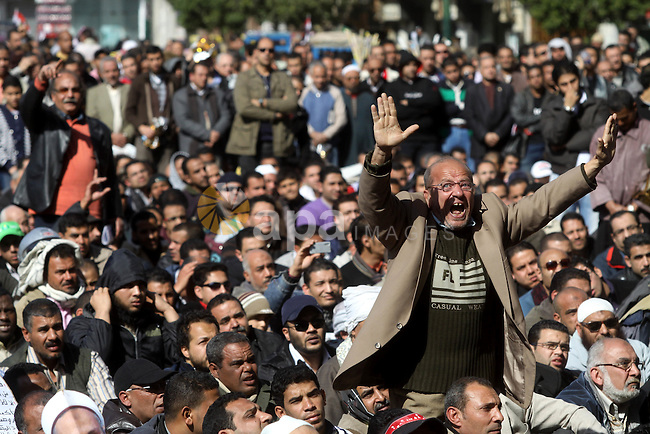 Egyptian demonstrators gather during a protest demanding the army to hand power to civilians at Tahrir square in Cairo on January 27, 2012, a year after a popular uprising. The protesters are demanding the implementation of the goals of the revolution, including an end to military trials of civilians, the restructuring of the interior ministry and a guarantee of freedoms and social justice. Photo by Naaman Omar