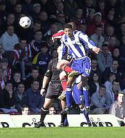 .Photo Peter Spurrier.06/04/2002.Nationwide Div 2.Brentford vs Huddersfield - Griffen Park:.Huddersfield's Dwanye Mattis out jumps Martin Rowlands...