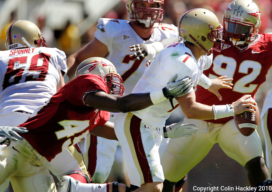 TALLAHASSEE, FL 10-FSU-BC FB10 CH-Florida State's Brandon Jenkins sacks Boston College's Chase Rettig during first half action Saturday at Doak Campbell Stadium in Tallahassee. .COLIN HACKLEY PHOTO
